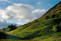Clouds above a green hillside in Glen Coe Scotland
