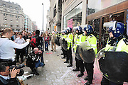 26.MARCH.2011. LONDON<br /> <br /> RIOT POLICE STAND TRY AND PROTECT THE TOP SHOP STORE ON OXFORD CIRCUS AFTER RIOTERS SMASH AND THROW PAINT ON THE WINDOWS OF THE STORE AS THE ANTI-CUTS PROTEST AGAINST THE BRITISH GOVERNMENT TURNS UGLY.<br /> <br /> BYLINE: EDBIMAGEARCHIVE.COM<br /> <br /> *THIS IMAGE IS STRICTLY FOR UK NEWSPAPERS AND MAGAZINES ONLY*<br /> *FOR WORLD WIDE SALES AND WEB USE PLEASE CONTACT EDBIMAGEARCHIVE - 0208 954 5968*