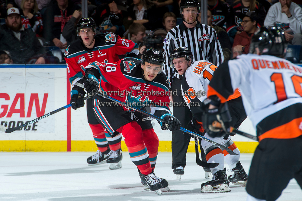 KELOWNA, CANADA - NOVEMBER 25: Carsen Twarynski #18 of the Kelowna Rockets looks for the puck after the face off against James Hamblin #10 of the Medicine Hat Tigers on November 25, 2017 at Prospera Place in Kelowna, British Columbia, Canada.  (Photo by Marissa Baecker/Shoot the Breeze)  *** Local Caption ***