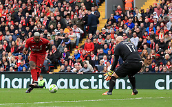 Liverpool's Djibril Cisse scores his side's second goal of the game during the Legends match at Anfield Stadium, Liverpool.