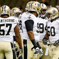 Sep 22, 2013; New Orleans, LA, USA; New Orleans Saints middle linebacker Curtis Lofton (50) huddles with teammates against the Arizona Cardinals before a game at Mercedes-Benz Superdome. The Saints defeated the Cardinals 31-7. Mandatory Credit: Derick E. Hingle-USA TODAY Sports