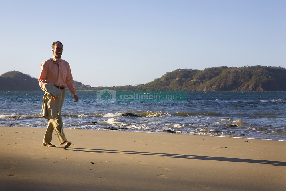 July 21, 2019 - Man In Suit Walking On Beach (Credit Image: © Caley Tse/Design Pics via ZUMA Wire)
