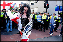 EDL supporter dressed as a woman attends the protest against what the EDL sees as the influence of Islam in the Tower Hamlets area of London, United Kingdom. Saturday, 7th September 2013. Picture by Piero Cruciatti / i-Images