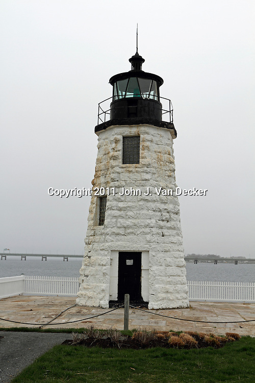 The Goat Island Lighthouse on a foggy day. Newport, Rhode Island, USA. The lighthouse sits on an island in Narragansett Bay.
