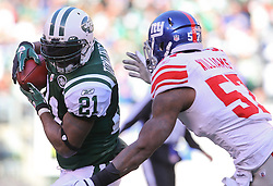 Dec 24, 2011; East Rutherford, NJ, USA; New York Giants linebacker Jacquian Williams (57) tackles New York Jets running back LaDainian Tomlinson (21) during the first half at MetLife Stadium.