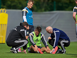 NEWPORT, WALES - Wednesday, October 8, 2014: Wales' Emyr Huws injured during training at Dragon Park National Football Development Centre ahead of the UEFA Euro 2016 qualifying match against Bosnia and Herzegovina. (Pic by David Rawcliffe/Propaganda)
