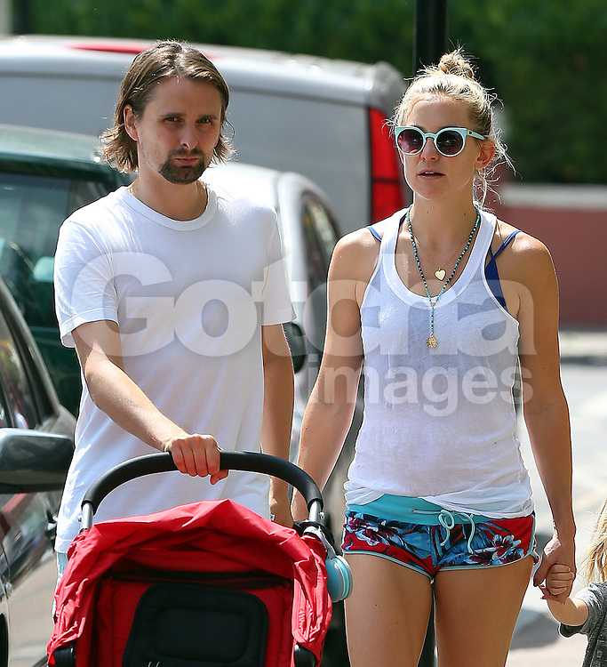 Actress Kate Hudson and partner Matthew Bellamy out and about in London. Kate was wearing a white vest top and a pair of cheeky little floral mini micro shorts enjoying the sunshine... UK. 24/07/2014<br />BYLINE MUST READ : JAMESY/GOTCHA IMAGES<br /><br />Copyright by &copy; Gotcha Images Ltd. All rights reserved.<br />Usage of this image is conditional upon the acceptance <br />of Gotcha Images Ltd, terms and conditions available at<br />www.gotchaimages.com