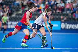 Surbiton's Abi Robinson is watched by Harriet Mitchell of University of Birmingham. University of Birmingham v Surbiton - Semi-Final - Investec Women's Hockey League Finals, Lee Valley Hockey & Tennis Centre, London, UK on 22 April 2017. Photo: Simon Parker