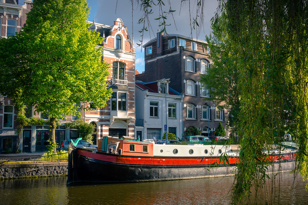 A spring morning along one of Amsterdam's canal in the Plantage neighborhood.