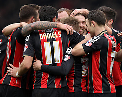 Bournemouth's Brett Pitman celebrates his third goal with his teammates - Photo mandatory by-line: Robbie Stephenson/JMP - Mobile: 07966 386802 - 14/03/2015 - SPORT - Football - Bournemouth - Dean Court - AFC Bournemouth v Blackpool - Sky Bet Championship