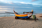 Traditional colorful Portuguese fishing boat on the beach at Vieira de Leiria. A Portuguese village and also a parish in the municipality of Marinha Grande, Portugal