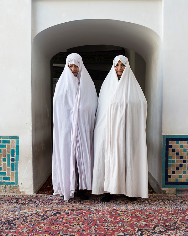 Portrait of two women in a mosque after the pray