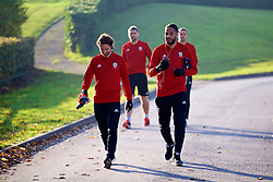 CARDIFF, WALES - Sunday, November 18, 2018: Wales' Joe Allen (L) and captain Ashley Williams during a training session at the Vale Resort ahead of the International Friendly match between Albania and Wales. (Pic by David Rawcliffe/Propaganda)