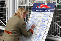 © Licensed to London News Pictures. 09/04/2016. Liverpool, UK. A bookkeeper marks up her prices on Grand National day of the Grand National 2016 at Aintree Racecourse near Liverpool. The race, which was first run in 1839, is the most valuable jump race in Europe. Photo credit : Ian Hinchliffe/LNP