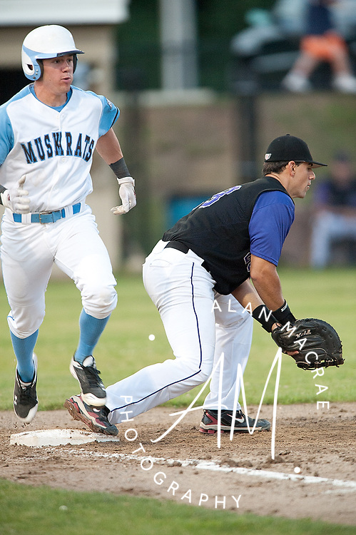Muskrats' Evan Marzilli makes it safely to first ahead of the catch by Keene Swampbats first baseman Brett Barrett in Sunday's game at Robbie Mills Memorial Sports Complex.  (Alan MacRae/for the Citizen)