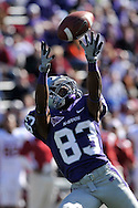 MANHATTAN, KS - OCTOBER 25:  Wide receiver Brandon Banks #83 of the Kansas State Wildcats reaches up for a pass in the second half against the Oklahoma Sooners on October 25, 2008 at Bill Snyder Family Stadium in Manhattan, Kansas.  The Oklahoma Sooners won 58-35.