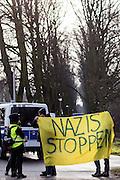 Magdeburg | 18 Jan 2014<br /> <br /> ACHTUNG BESONDERE HONORARKONDITIONEN!<br /> <br /> Am Samstag (19.01.2014) marschierten etwa 1000 Neonazis bei einem &quot;Gedenkmarsch&quot; durch Magdeburg, um der Bombardierungen der Stadt im 2. Weltkrieg zu &quot;gedenken&quot;.<br /> Hier: Anti-Nazi-Demonstranten mit einem Transparent mit der Aufschrift &quot;Nazis stoppen&quot; an der Haltestelle Magdeburg-Herrenkrug.<br /> <br /> &copy;peter-juelich.com<br /> <br /> [No Model Release | No Property Release]