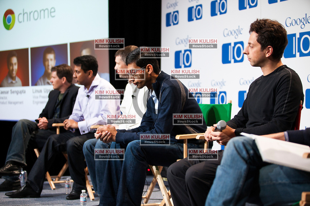 Sundar Pichai, Sr VP at Google ,(c) and Sergey Brin, co-founder of Google Inc., (R) attend a press conference on the new Google Chomebook at the Google I/O developer's conference in San Francisco, California.