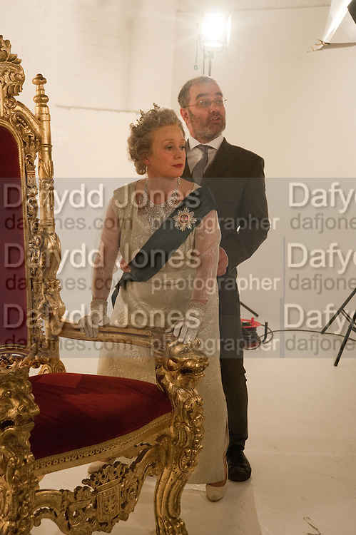 CORINNE AS THE QUEEN; SLY, filming for Sly and Reggie ' Dub Save the Queen. Moorish Rd. London Sw2. 5 April 2012.