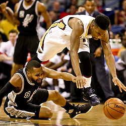 Mar 3, 2016; New Orleans, LA, USA; New Orleans Pelicans guard Norris Cole (30) and San Antonio Spurs guard Patty Mills (8) scramble for a loose ball during the second quarter of a game at the Smoothie King Center. Mandatory Credit: Derick E. Hingle-USA TODAY Sports