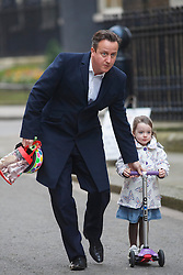 © licensed to London News Pictures. London, UK 21/01/2014. Prime minister David Cameron taking his daughter Florence to nursery before a cabinet meeting on Downing Street on Tuesday, 21 January 2014. Photo credit: Tolga Akmen/LNP