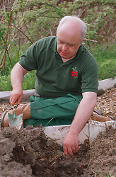 Man with Downs Syndrome gardening,