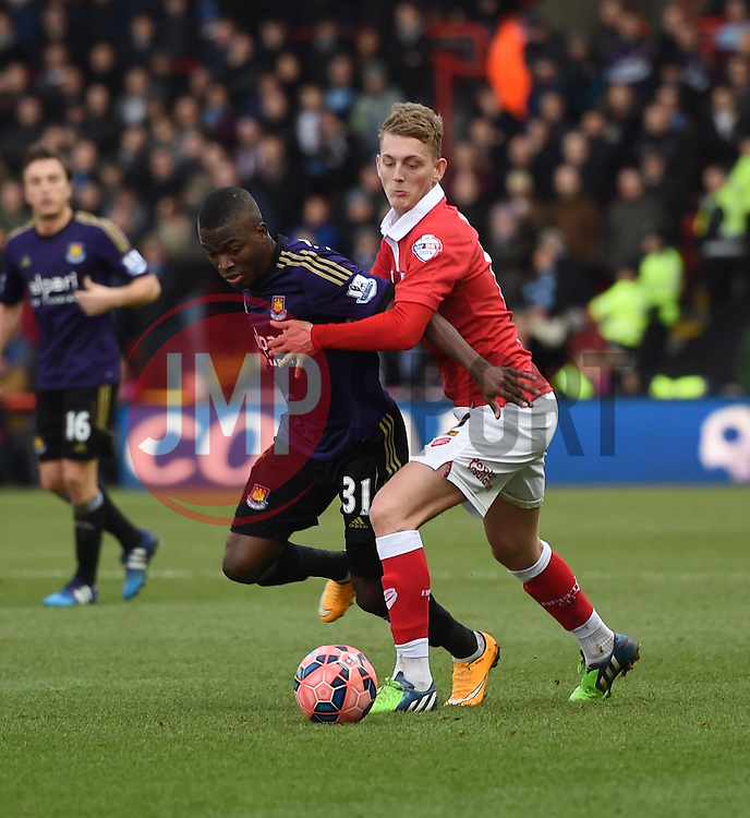 Bristol City's George Saville tussles with West Ham's Enner Valencia in the FA Cup fourth round match between Bristol City and West Ham United at Ashton Gate on 25 January 2015 in Bristol, England - Photo mandatory by-line: Paul Knight/JMP - Mobile: 07966 386802 - 25/01/2015 - SPORT - Football - Bristol - Ashton Gate - Bristol City v West Ham United - FA Cup fourth round