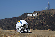 General overall view of Los Angeles Chargers helmet with the Hollywood sign and Mount Lee as a backdrop in Los Angeles, Wednesday. Sept. 19, 2018. Chargers owner Dean Spanos relocated the franchise to Los Angeles from San Diego in 2017.