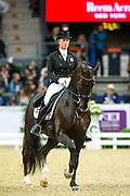 Anna Kasprzak - Donnperignon<br /> Reem Acra FEI World Cup Final 2013<br /> © DigiShots
