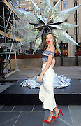 Miranda Kerr poses for a photo before the Swarovski Star is raised to the top of the Rockefeller Center Christmas Tree, Monday, Nov. 16, 2015, in New York. (Diane Bondareff/AP Images for Swarovski)