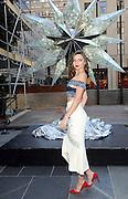 Miranda Kerr poses for a photo before the Swarovski Star is raised to the top of the Rockefeller Center Christmas Tree, Monday, Nov. 16, 2015, in New York. (Diane Bondareff/AP Images for Swarovski)
