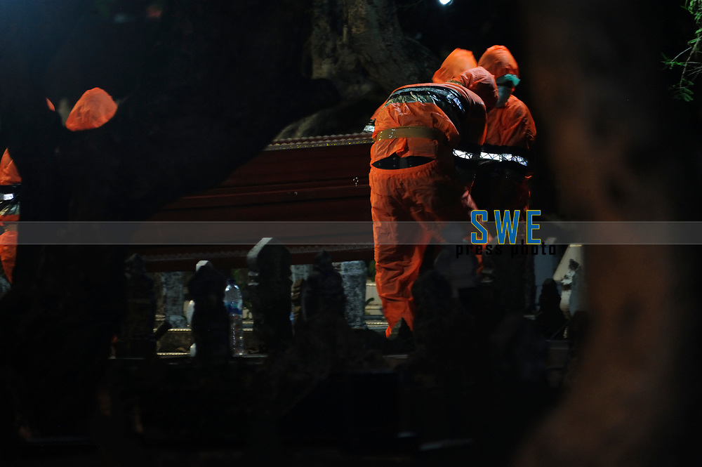 Medan, Indonesia, March 25, 2020: Indonesian social volunteer grroup (local residents) seen during bury a dead body victims of Corona Virus Disease (COVID) 19 spread of Medan in a public cemetery in North Sumatra province, Indonesia on March 25, 2020.