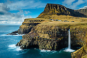 The waterfall, Múlafossur, flows near the picturesque village of Gásadalur in the Faroe Islands