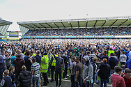 Millwall fans invade the pitch after the final whistle after the Sky Bet Championship match at The Den, London<br /> Picture by David Horn/Focus Images Ltd +44 7545 970036<br /> 03/05/2014
