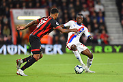 Aaron Wan-Bissaka (29) of Crystal Palace lookig for a way past Joshua King (17) of AFC Bournemouth during the Premier League match between Bournemouth and Crystal Palace at the Vitality Stadium, Bournemouth, England on 1 October 2018.