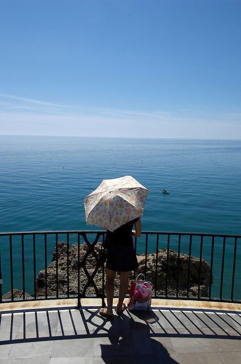 A tourist in Nerja on the Balcon de Europa; Costa del Sol; Spain;