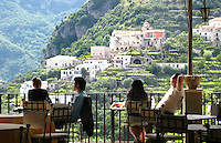 Diners relax and enjoy the view at a restaurant in Ravello, Italy.