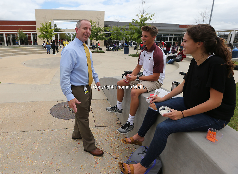 Tupelo High School principal Art Dobbs chats with Peyton Puckett and Lexie Freeman during their lunch break on Wednesday.