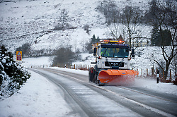 © Licensed to London News Pictures. 27/12/2014. Horseshoe Pass, Denbighshire, UK. A snowplough keeps the road clear. Snow continues to fall on high ground in Wales.<br />   Photo credit: Graham M. Lawrence/LNP