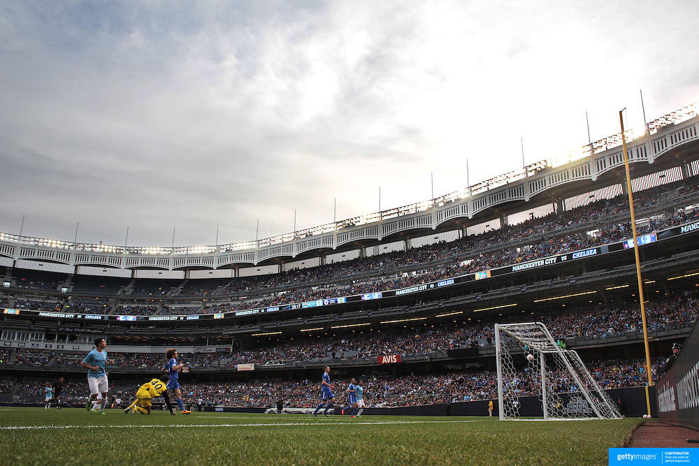 Samir Nasri, (left), Manchester City, scores the first of his two goals during the Manchester City V Chelsea friendly exhibition match at Yankee Stadium, The Bronx, New York. Manchester City won the match 5-3. New York. USA. 25th May 2012. Photo Tim Clayton