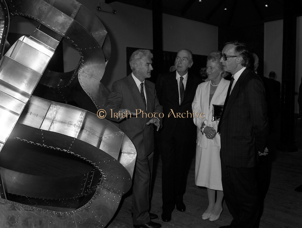 19/08/1988<br /> 08/19/1988<br /> 19 August 1988<br /> Opening of ROSC '88 at the Guinness Hop Store, Dublin. Patrick Murphy, ROSC Chairman, ( left) explains an exhibit to President Patrick Hillery (second from left) who officially opened the exhibition;  Maeve Hillery and  Harry Byrne (right)  Financial Director, Guinness Ireland.