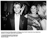 Leonardo DiCaprio and  Sharon Stone at  Producer Steve Tisch &  Vanity Fair's Oscar Night Party,<br />Mortons,  Los Angeles. March 1994.  Film 94559/24<br /> <br />© Copyright Photograph by Dafydd Jones<br />66 Stockwell Park Rd. London SW9 0DA<br />Tel 0171 733 0108.