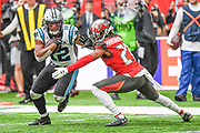Tampa Bay Buccaneers Defensive Back Vernon Hargreaves (28) comes in to tackle Carolina Panthers Wide Receiver D. J. Moore (12) during the International Series match between Tampa Bay Buccaneers and Carolina Panthers at Tottenham Hotspur Stadium, London, United Kingdom on 13 October 2019.