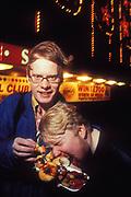 Two men eating Junk food at night, UK 2000's