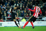 Liverpool defender Nathaniel Clyne (#2) lines up to shoot as Sunderland defender Papy Djilobodji (#5) attempts to black during the Premier League match between Sunderland and Liverpool at the Stadium Of Light, Sunderland, England on 2 January 2017. Photo by Craig Doyle.