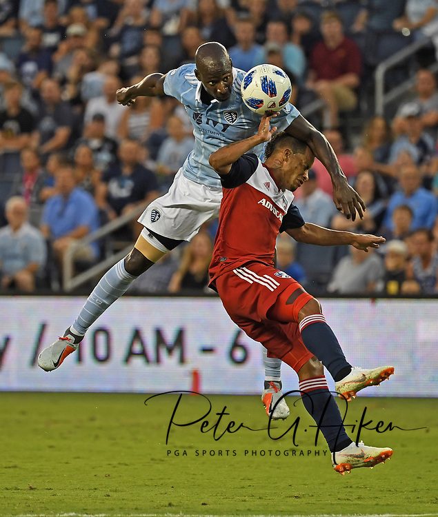 Sporting Kansas City defender Ike Opara (3) heads the ball during the first half against FC Dallas midfielder Michael Barrios (21) at Children's Mercy Park.