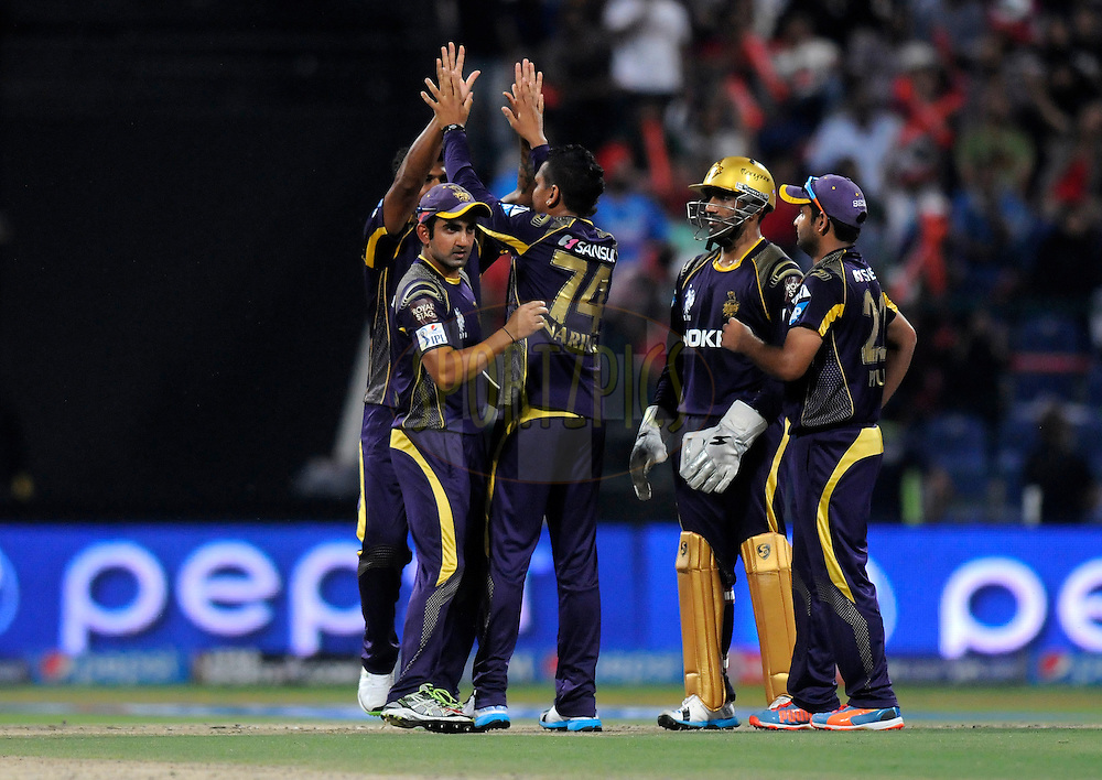 Sunil Narine of the Kolkata Knight Riders celebrates the wicket of Mitchell Johnson of the Kings X1 Punjab during match 15 of the Pepsi Indian Premier League 2014 Season between The Kings XI Punjab and the Kolkata Knight Riders held at the Sheikh Zayed Stadium, Abu Dhabi, United Arab Emirates on the 26th April 2014<br /> <br /> Photo by Pal Pillai / IPL / SPORTZPICS