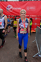 Ashley James (Made In Chelsea star and TV presenter running for Cancer Research UK) smiles with her medal after finishing the race. The Virgin Money London Marathon, 23rd April 2017.<br /> <br /> Photo: Joanne Davidson for Virgin Money London Marathon<br /> <br /> For further information: media@londonmarathonevents.co.uk