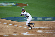 LOS ANGELES, CA - MARCH 22: Third baseman Munenori Kawasaki #52 of Japan attempts a bunt against USA in game two of the semifinal round of the 2009 World Baseball Classic at Dodger Stadium in Los Angeles, California on Sunday March 22, 2009. Japan defeated USA 9-4. (Photo by Paul Spinelli/WBCI/MLB Photos) *** Local Caption *** Munenori Kawasaki