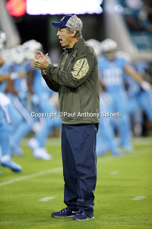 Tennessee Titans assistant head coach / defense Dick LeBeau claps his hands during pregame warmups before the 2015 week 11 regular season NFL football game against the Jacksonville Jaguars on Thursday, Nov. 19, 2015 in Jacksonville, Fla. The Jaguars won the game 19-13. (©Paul Anthony Spinelli)